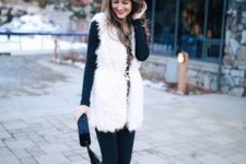 13 graphite grey leggings, a matching long sleeve top, black booties and a white faux fur vest