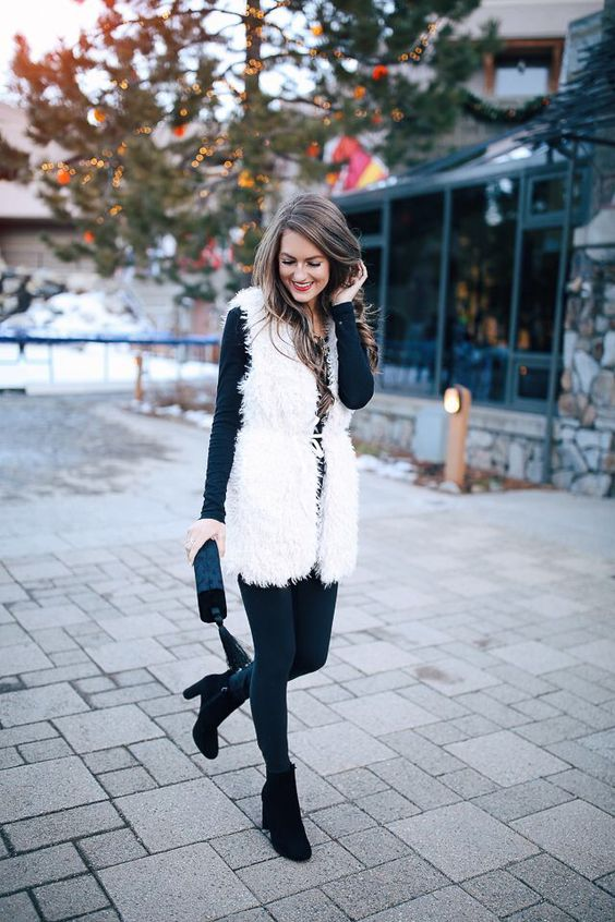 graphite grey leggings, a matching long sleeve top, black booties and a white faux fur vest