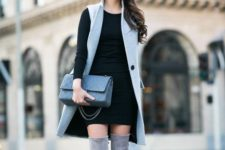 13 grey tall boots, a black mini dress with long sleeves, a grey long waistcoat and a grey bag