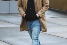 13 light blue jeans, black trainers, a black hoodie, a camel coat for a simple and casual outfit