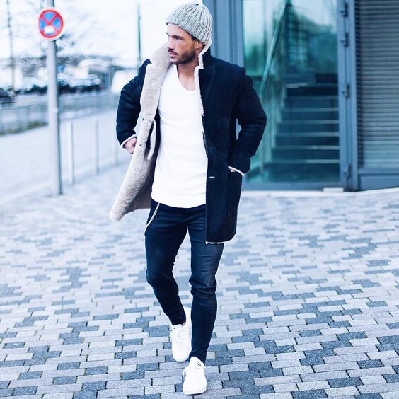navy denim, white sneakers, a white long sleeves, a black and white shearling coat, a grey beanie