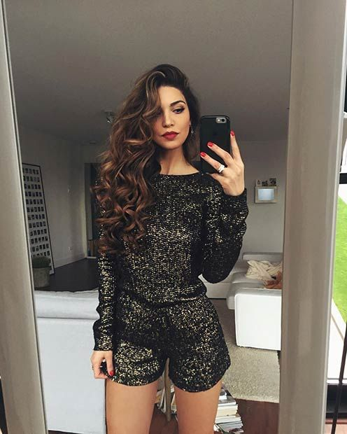 a black sequin romper with long sleeves will show off your legs, just add a red lip and nails