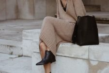 14 a camel knit midi dress with a black top underneath, black booties and a black bag