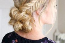 14 a low bun with two fishtail side braids and a bump is a chic and comfy to wear option