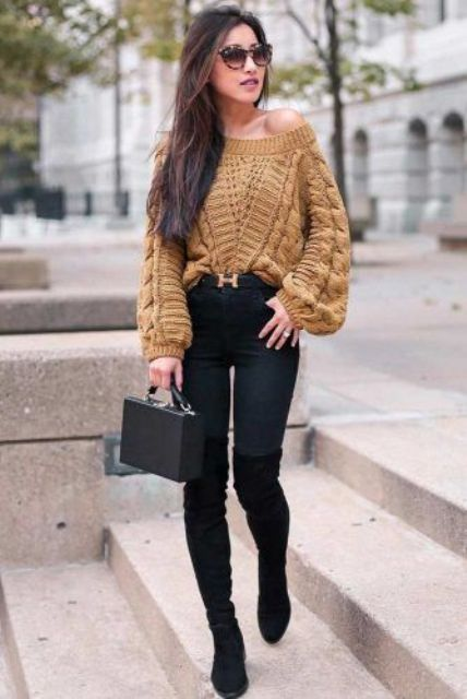a mustard one shoulder sweater, black skinnies, black tall boots and a small black bag