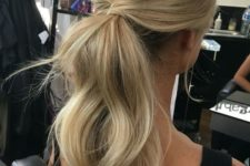 14 a twisted dimensional low ponytail with a bump is a timeless and chic idea for any occasion