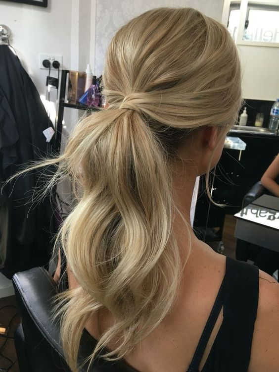 a twisted dimensional low ponytail with a bump is a timeless and chic idea for any occasion