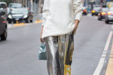 14 a white sweater, a faux fur scarf, silver textural pants and a mint bag for a statement outfit
