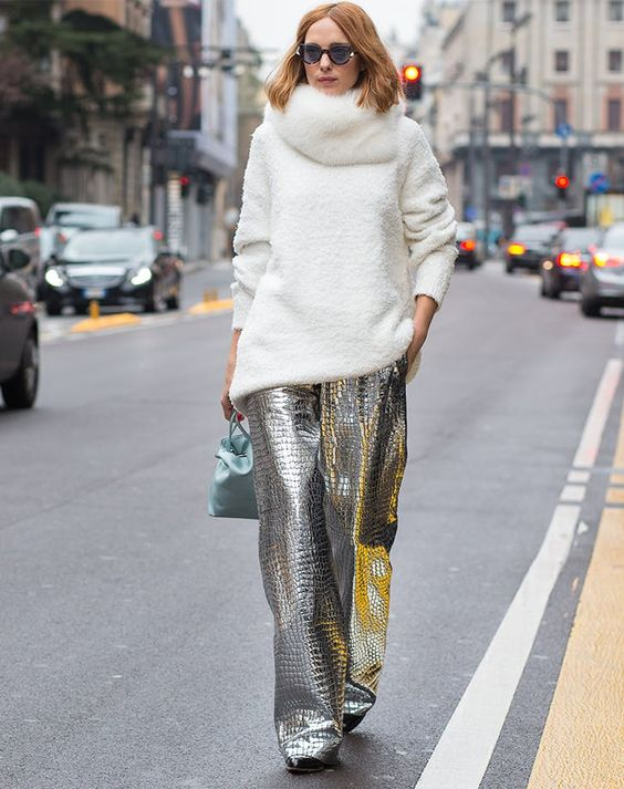a white sweater, a faux fur scarf, silver textural pants and a mint bag for a statement outfit