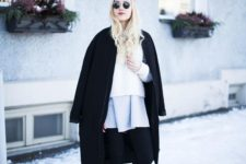 14 a white sweater, a grey pleated mini, black boots, a black coat is a stylish statement