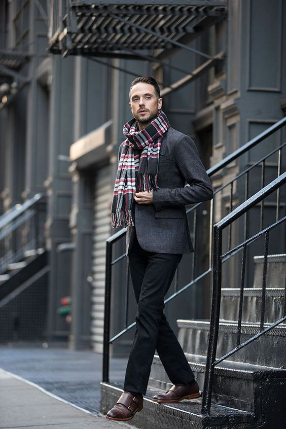 black pants, a grey blazer, brown shoes and a bold plaid scarf for a comfy holiday look