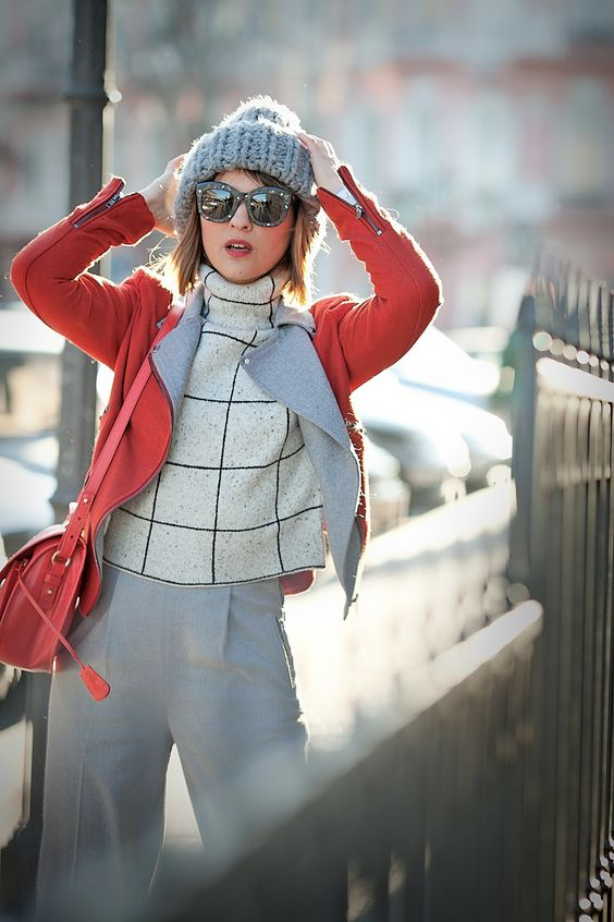 grey culottes, a windowpane print sweater, a coral jacket, a coral bag, a grey beanie