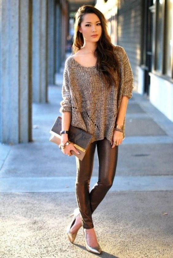 leather leggings, metallic shoes, a chunky knit sweater, a printed cluch for a casual New Year's party look