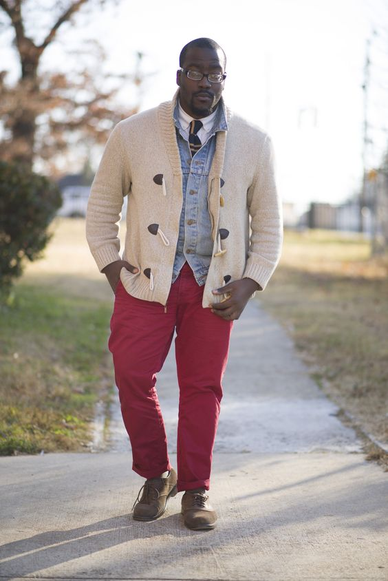 red pants, a white shirt with a tie, a denim jacket, a comfy cardigan and shoes for warm days