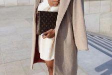 15 a creamy oversized turtleneck sweater dress, sneakers and a midi camel coat plus a printed clutch