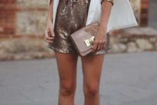 15 a rose gold romper with a plunging neckline, nude heels, a matching clutch and a white cape
