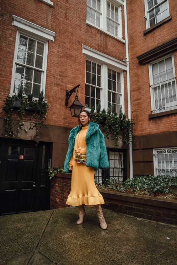 a yellow midi dress, an emerald fur coat, beige boots for a more formal date