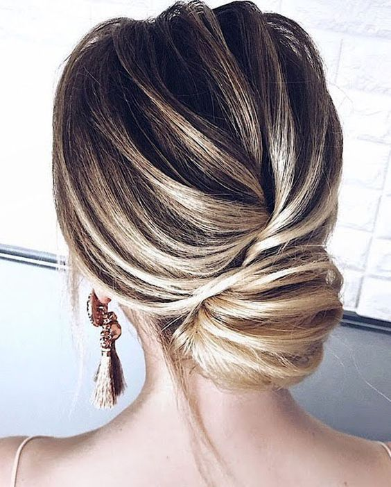 an elegant yet simple Christmas low chignon hairstyle with a bump and some bangs is an ideal hairstyle for a party