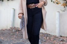 15 black jeans, a black lace top, a long neutral cardigan, black boots and a belt to highlight the waist