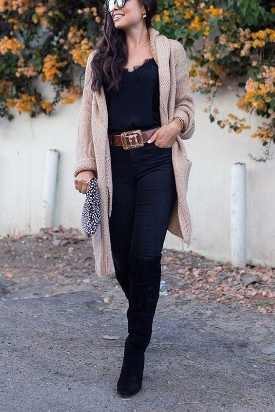 black jeans, a black lace top, a long neutral cardigan, black boots and a belt to highlight the waist
