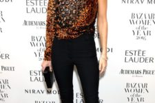 15 black pants, black heels, a one shoulder leopard print sparkly top and long sequin earrings for New Year