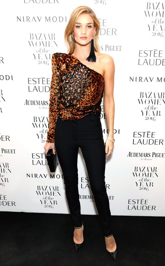 black pants, black heels, a one shoulder leopard print sparkly top and long sequin earrings for New Year