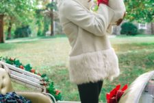 15 black skinnies, a white shearlign coat with fur, a red pompom beanie and red gloves