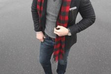 15 navy jeans, a white shirt with a tie, a grey jumper, brown shoes, a grey tweed blazer and a plaid scarf