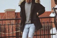 15 pale ripped denim, yellow boots, a grey sweater and a black puffer jacket are all you need for a casual look