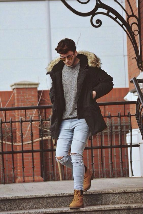 pale ripped denim, yellow boots, a grey sweater and a black puffer jacket are all you need for a casual look