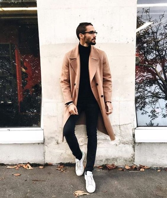 a black turtleneck, black jeans, white sneakers and a camel overcoat plus glasses for a casual work look