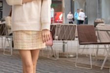 16 a neutral oversized sweater, a tweed mini skirt, white booties for a simple girlish look