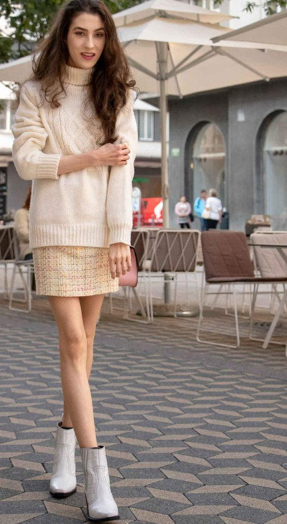 a neutral oversized sweater, a tweed mini skirt, white booties for a simple girlish look
