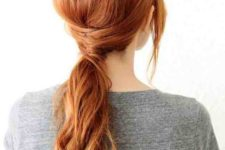 16 a twisted low ponytail hairstyle with bangs and textures in the ponytail is a fresh take on traditional ponytails