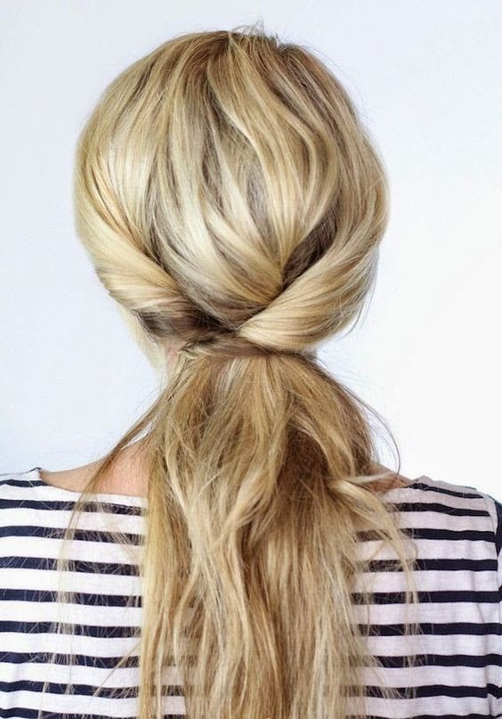 a twisted messy ponytail with a bump is a cool idea to show off your long hair