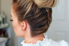 16 an elegant top knot with a bump and a braid on the back is a cute and fun option