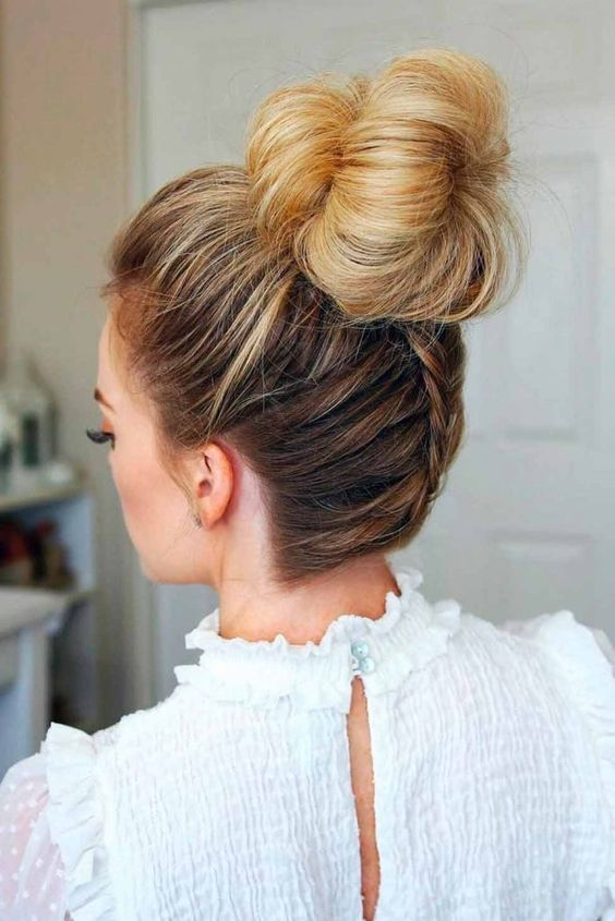 an elegant top knot with a bump and a braid on the back is a cute and fun option