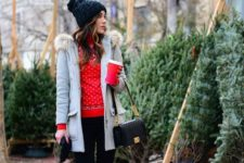 16 black tall boots navy skinnies, a red sweater, a grey coat with fur, a black beanie and bag