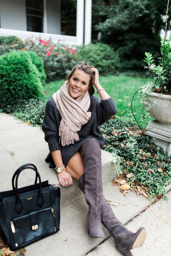 grey tall boots, a graphite grey sweater dress, a warm scarf and a black bag