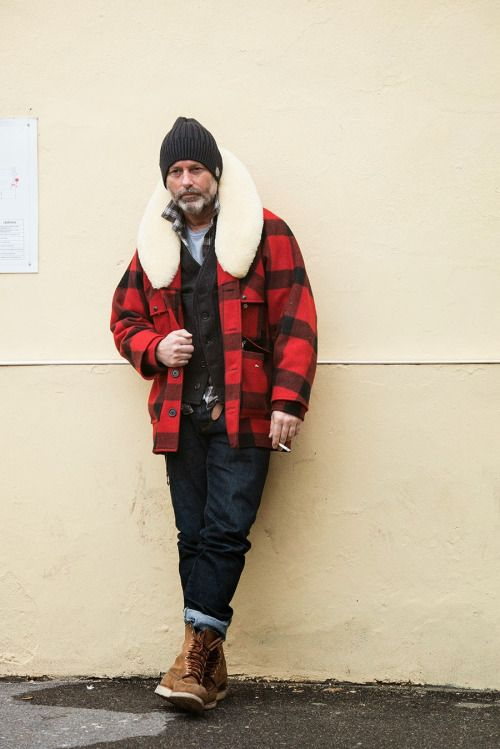 navy jeans, tall tan boots, a tee, a brown cardigan, a plaid coat with fut and a black beanie