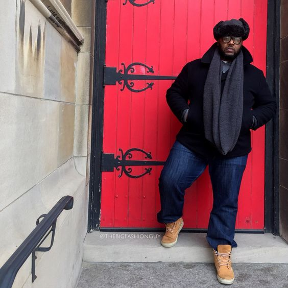 timberland boots, navy jeans, a trendy fur hat and a black short coat plus a scarf