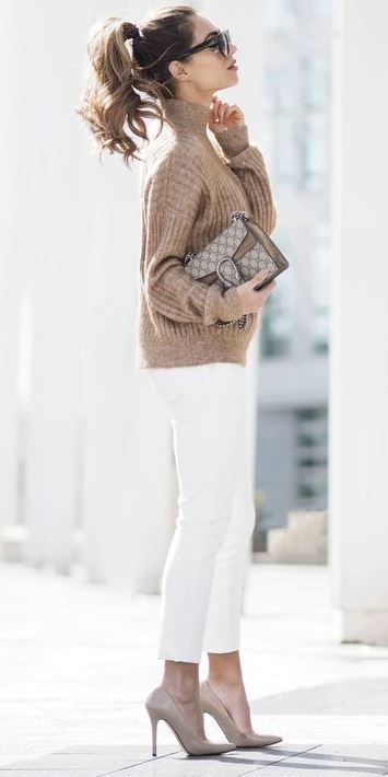 white jeans, nude shoes, a neutral turtleneck sweater and a printed bag for a preppy date look