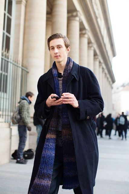 Navy blue coat, trousers, sweater and colorful striped long scarf