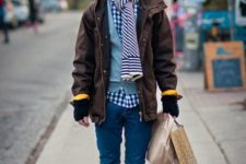 Pom pom beanie, checked shirt, light blue sweater, brown jacket, cuffed jeans, lace up boots and striped scarf