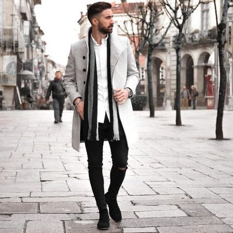 White button down shirt, striped scarf, gray coat, black boots and distressed pants