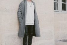 With beanie hat, gray midi coat, white t-shirt and black leather pants