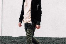 With beige hoodie, black blazer and olive green pants