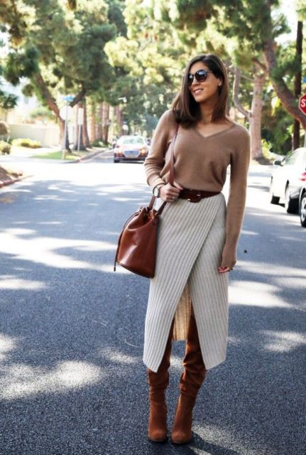 With beige shirt, brown leather tote and brown suede boots
