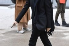 With black blazer, scarf and straight trousers