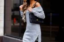 With black chain strap bag and black suede boots